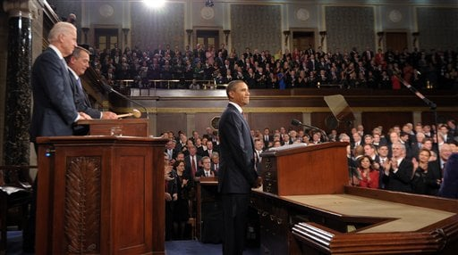 President Barack Obama pauses before he delivers his State of the Union address on Capitol Hill in Washington, Tuesday, Jan. 24, 2012. At left are Vice President Joe Biden and House Speaker John Boehner. (AP Photo/Saul Loeb, Pool)