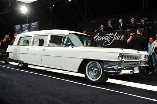 In this photo provided by Barrett-Jackson, the white hearse used to transport President John F. Kennedy's body following his assassination in Dallas is shown at auction Saturday, Jan. 21, 2012 in Scottsdale, Ariz.