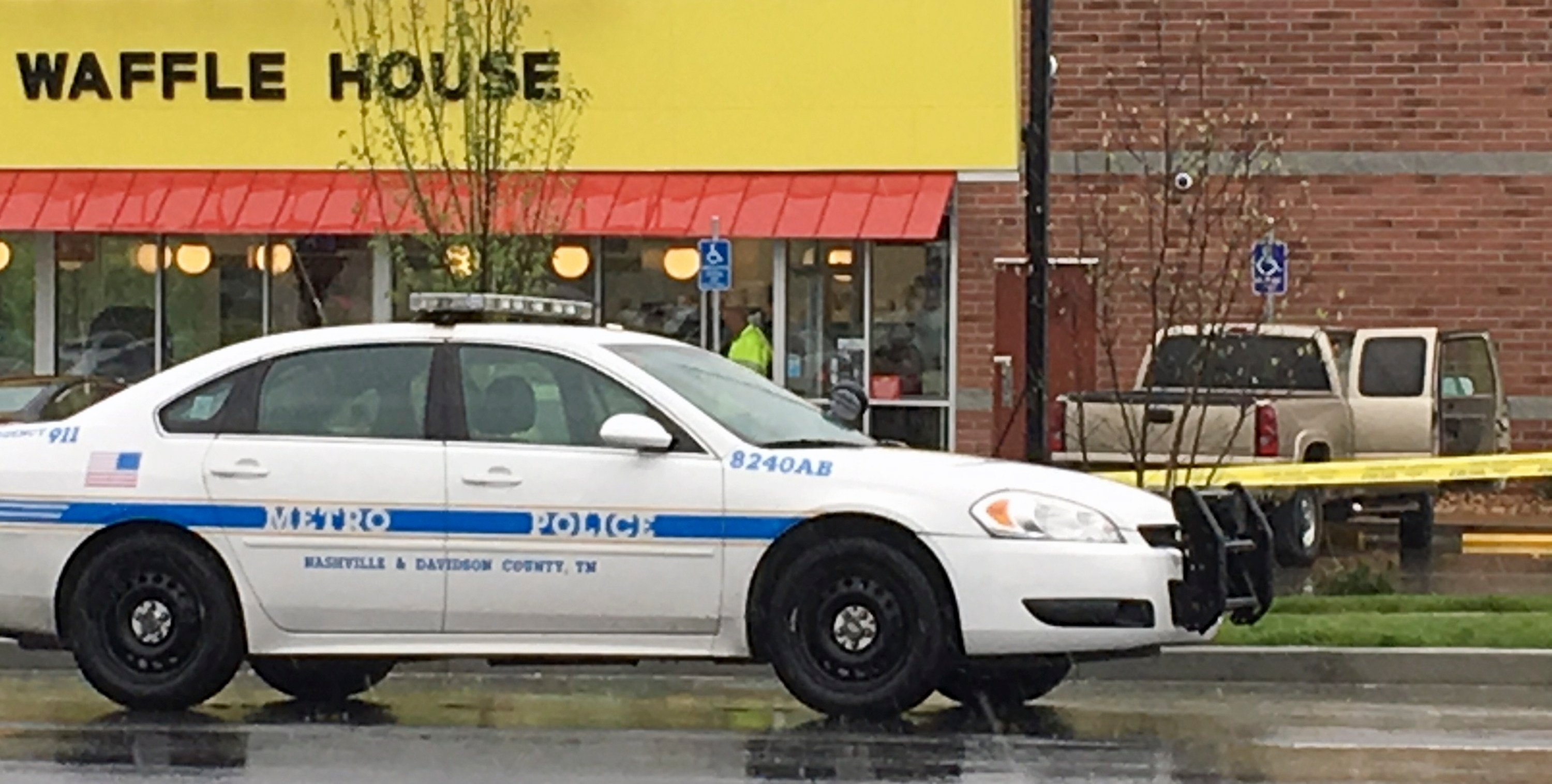 A police vehicle sits outside a Waffle House restaurant in Nashville, Tenn., Sunday, April 22, 2018. (AP Photo/Sheila Burke)