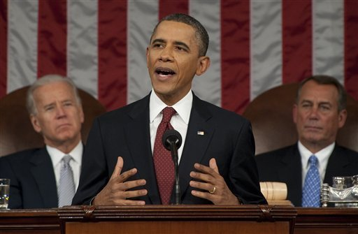 President Barack Obama delivers his State of the Union address on Capitol Hill in Washington, Tuesday, Jan. 24, 2012, as Vice President Joe Biden and House Speaker John Boehner, right, listne. (AP Photo/Saul Loeb, Pool)