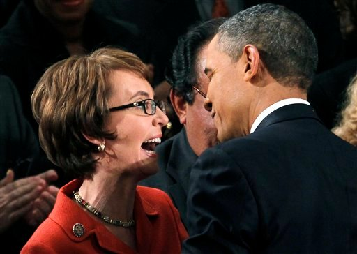 President Barack Obama greets retiring Rep. Gabrielle Giffords, D-Ariz., on Capitol Hill in Washington, Tuesday, Jan. 24, 2012, prior to delivering his State of the Union address. (AP Photo/Pablo Martinez Monsivais)
