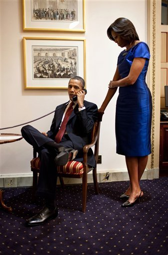 President Barack Obama on a phone call from the Capitol in Washington Jan. 24, 2012, immediately after his SOTU address, informing John Buchanan that his daughter Jessica was rescued by U.S. Special Operations Forces in Somalia. (AP Photo/Pete Souza, WH)