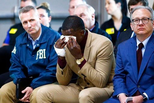 Hero James Shaw wipes tears away during a press conference on the Waffle House shooting Sunday, April 22, 2018 in Nashville, Tenn.