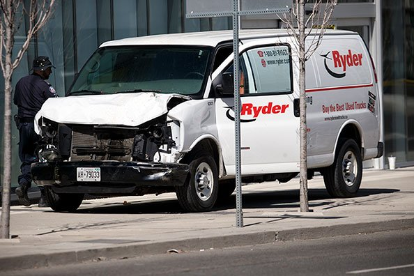 Police inspect a van suspected of being involved in a collision injuring at least eight people at Yonge St. and Finch Ave. on April 23, 2018 in Toronto, Canada.(Photo by Cole Burston/Getty Images)