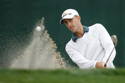 Geoff Ogilvy of Australia blasts out of a sand trap on the sixth green during the third round of the US Open championship at Torrey Pines Golf Course in this June 14, 2008 file photo taken in San Diego.