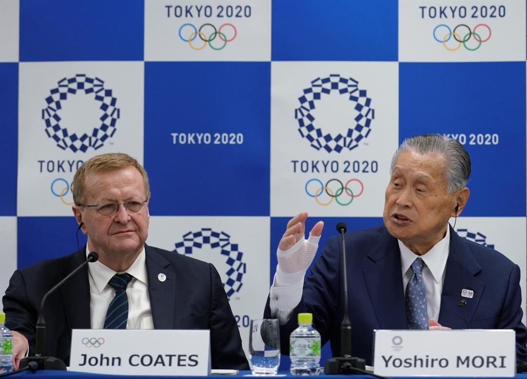International Olympic Committee Vice President John Coates listens as Yoshiro Mori, president of the Tokyo Organizing Committee of the Olympic and Paralympic Games, speaks during their joint press conference in Tokyo. (AP Photo/Eugene Hoshiko)