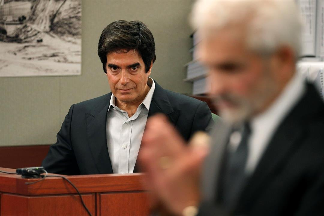 Illusionist David Copperfield, left, listens to questions from attorney Benedict Morelli, right, in court Wednesday, April 18, 2018, in Las Vegas. (AP Photo/John Locher)