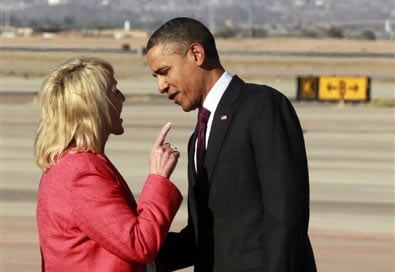 Arizona Gov. Jan Brewer points at President Barack Obama after he arrived at Phoenix-Mesa Gateway Airport, Wednesday, Jan. 25, 2012, in Mesa, Ariz. (AP Photo/Haraz N. Ghanbari)