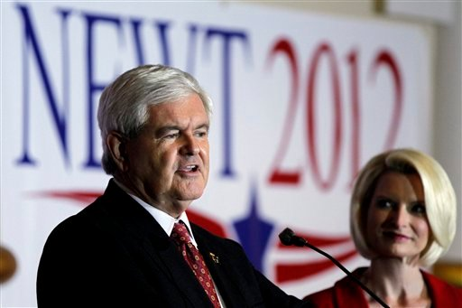 Republican presidential candidate former House Speaker Newt Gingrich accompanied by his wife Callista speaks during an event at a Holiday Inn, Wednesday, Jan. 25, 2012, in Cocoa, Fla. (AP Photo/Matt Rourke)