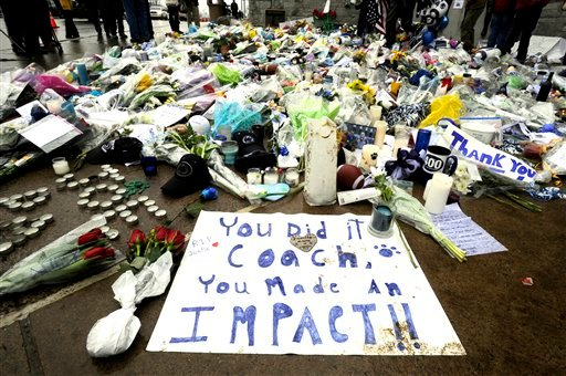 Flower, candles and other memorabilia are shown near the statue of former Penn State football coach Joe Paterno in front of Beaver Stadium in State College, Pa., Thursday, Jan. 26, 2012. (AP Photo/York Daily Record, Jason Plotkin)
