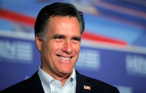 Republican presidential candidate, former Massachusetts Gov. Mitt Romney smiles as his wife Ann introduces him at The Hispanic Leadership Network's Lunch at Doral Golf Resort and Spa in Miami, Fla., Friday, Jan. 27, 2012. (AP Photo/Charles Dharapak)