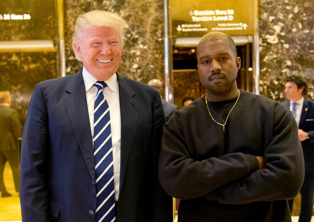 FILE - In this Dec. 13, 2016, file photo, President-elect Donald Trump and Kanye West pose for a picture in the lobby of Trump Tower in New York. West has deleted tweets posted on Dec. 13, 2016, explaining the meeting. (AP Photo/Seth Wenig, File)