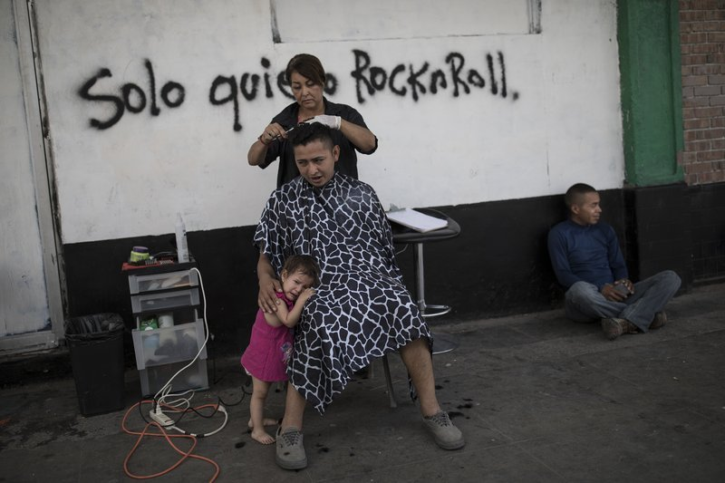 A migrant family gets ready for the three hour bus trip to Tijuana, at the Alfa & Omega migrant shelter in Mexicali, Mexico, Thursday, April 26, 2018, as they travel with a caravan of Central American migrants.