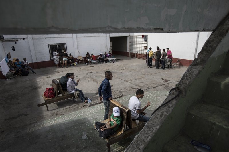 Migrants rest in the patio of the Alfa & Omega migrant shelter in Mexicali, Mexico, Thursday, April 26, 2018, as they travel north with a caravan of Central American migrants.
