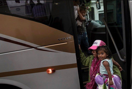 A Central American migrant and her children who are traveling with a caravan, arrive by bus to Tijuana, Mexico, Thursday, April 26, 2018. (AP Photo/Hans-Maximo Musielik)
