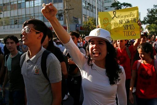 A student chants slogans to protest the murder of three film students who have become emblematic of Mexico's missing, in Guadalajara, Mexico, Thursday, April 26, 2018.