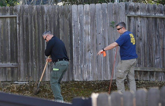 Authorities probe the backyard of the home of murder suspect Joseph DeAngelo, Thursday, April 26, 2018, in Citrus Heights, Calif. (AP Photo/Rich Pedroncelli)