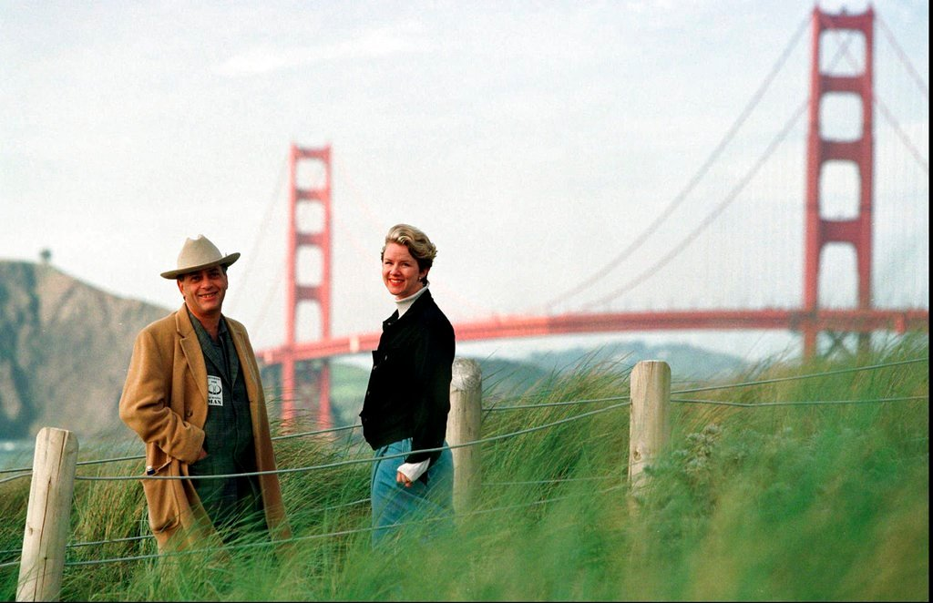 "In this 1998 photo, Larry Harvey and Marian Goodell, two of the founders of the Burning Man festival with the Golden Gate Bridge in the background. Harvey, the co-founder of the ""Burning Man"" festival has died. (AP Photo/Eric Risberg, File)"