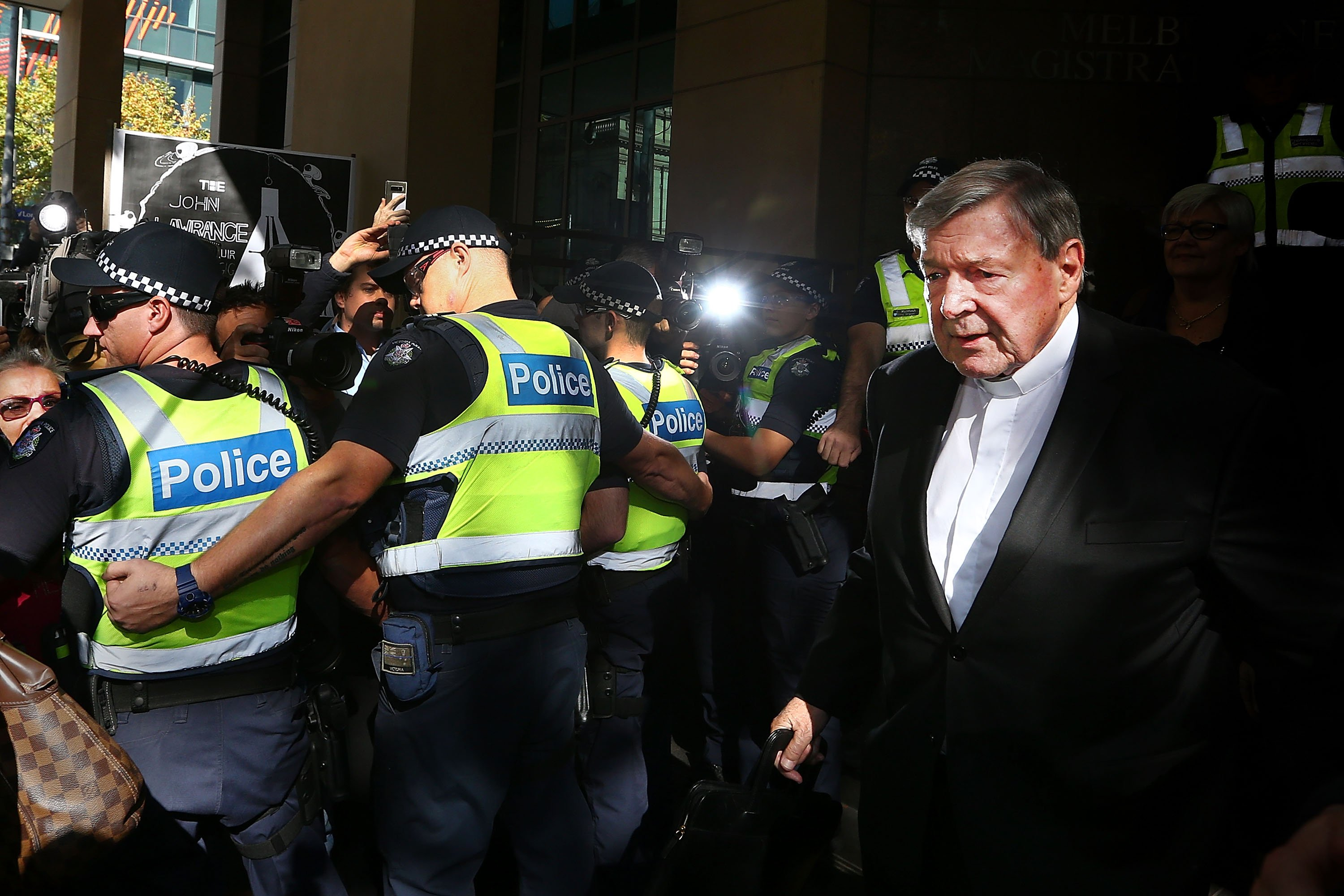 Cardinal George Pell leaves at Melbourne Magistrates' Court in Melbourne, Australia. Cardinal Pell was charged on summons by Victoria Police over allegations of sexual assault. (Photo by Michael Dodge/Getty Images)