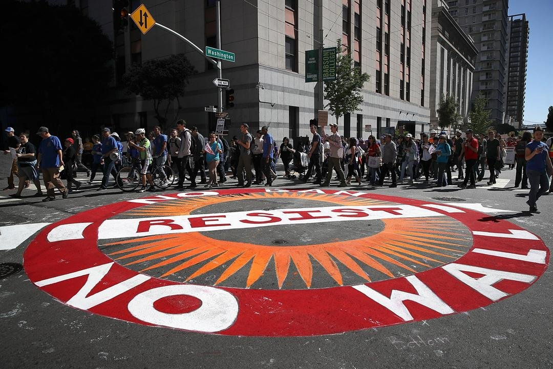 SAN FRANCISCO, CA - MAY 01: Protesters march during a May Day demonstration outside of a U.S. Immigration and Customs Enforcement (ICE) office. (Photo by Justin Sullivan/Getty Images)