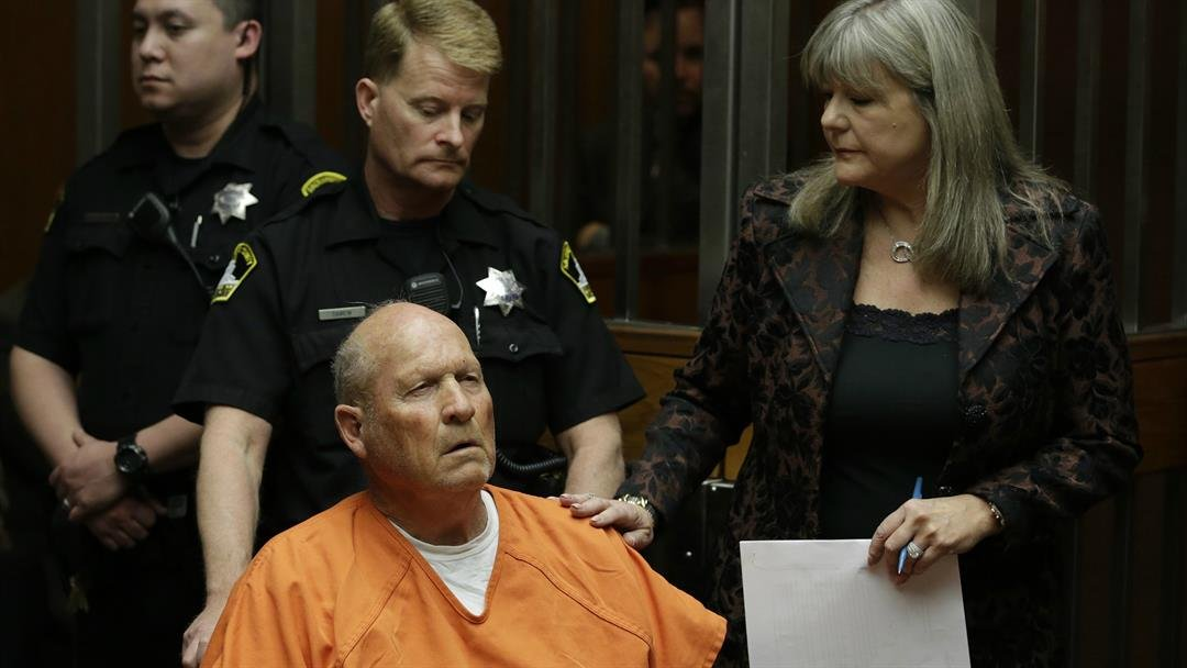 Joseph James DeAngelo, accompanied by Sacramento County Public Defender Diane Howard, makes his first appearance to face charges that include homicide and rape, in Sacramento County Superior Court on Friday, April 27. (AP Photo/Rich Pedroncelli, file)