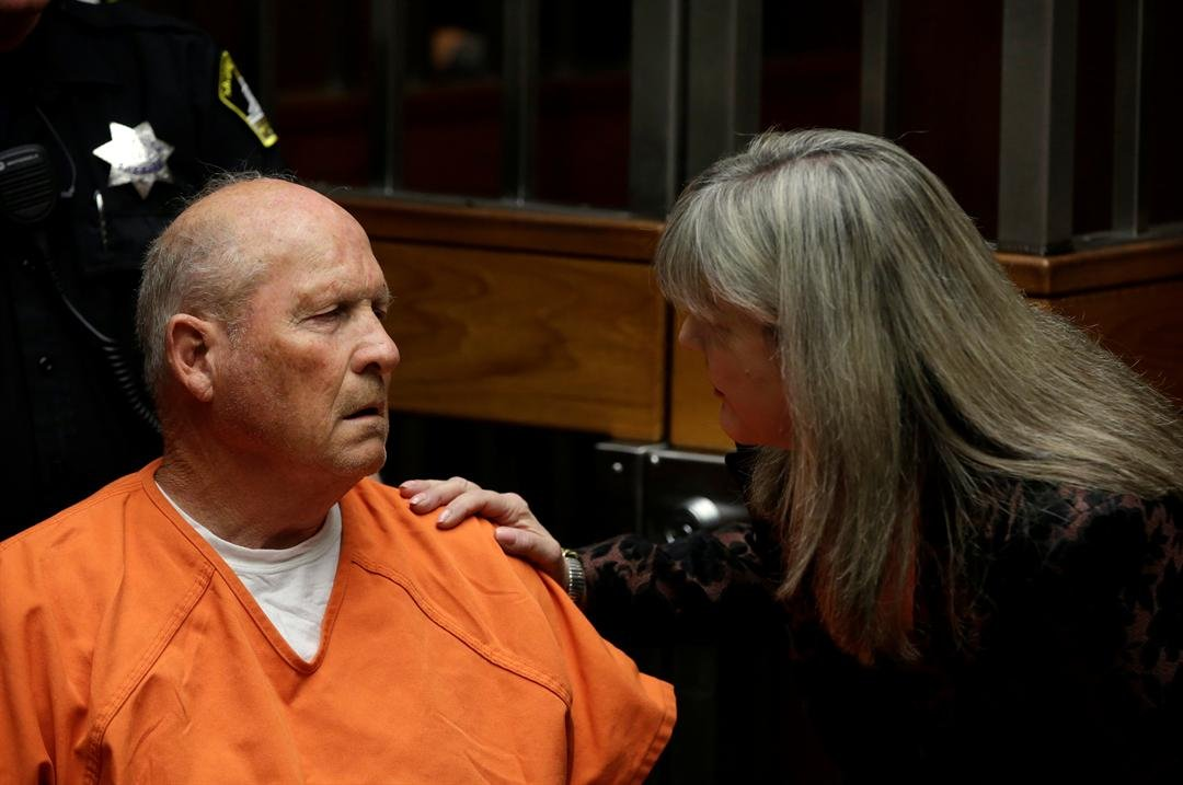 Joseph James DeAngelo talks with Sacramento County Public Defender Diane Howard, right, during his first appearance to face charges that include homicide and rape, in Sacramento County Superior Court in Sacramento. (AP Photo/Rich Pedroncelli, File)