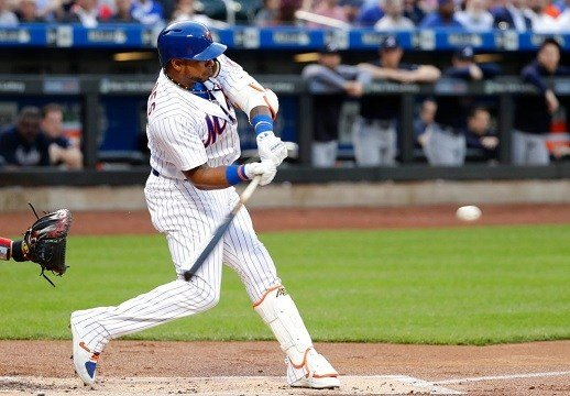 New York Mets' Yoenis Cespedes hits a double during the first inning of the team's baseball game against the Atlanta Braves on Wednesday, May 2, 2018, in New York. (AP Photo/Frank Franklin II)