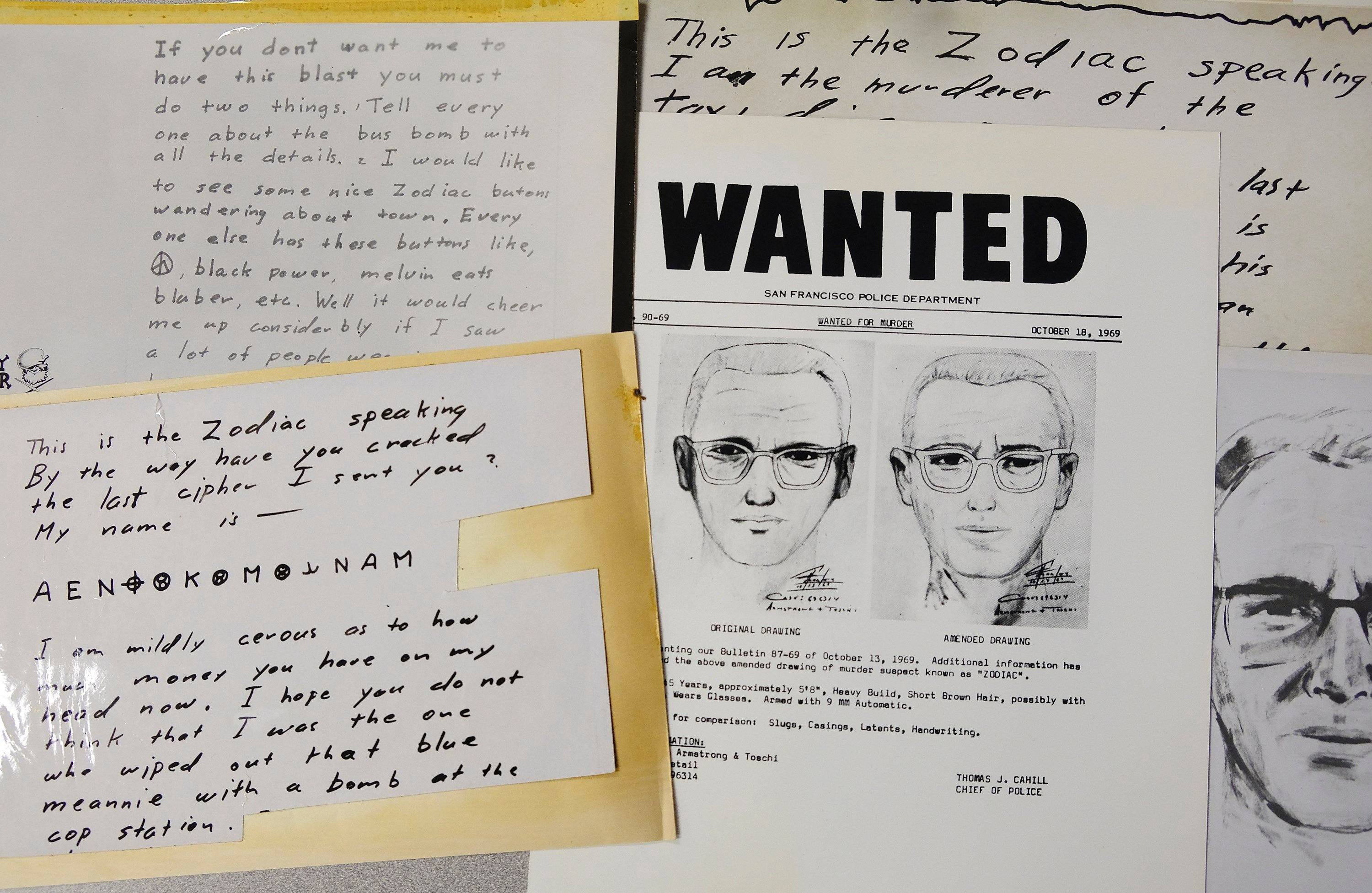 A San Francisco Police Department wanted bulletin and copies of letters sent to the San Francisco Chronicle by a man who called himself Zodiac are displayed Thursday, May 3, 2018, in San Francisco. (AP Photo/Eric Risberg)