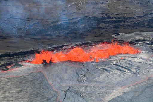 In this April 22, 2018 photo provided by the U.S. Geological Survey, lava spatters at the edge of Kilauea's Halemaumau Crater in Hawaii Volcanoes National Park on Hawaii's Big Island.