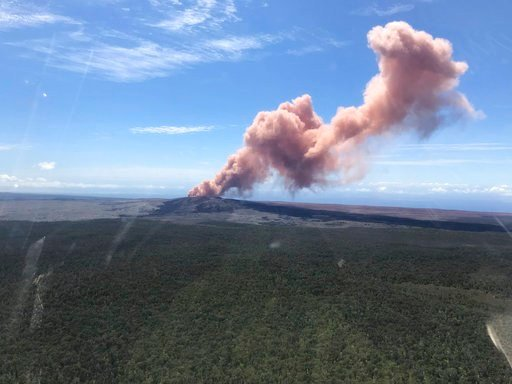 In this photo provided by the U.S. Geological Survey, red ash rises from the Puu Oo vent on Hawaii's Kilauea Volcano after a magnitude-5.0 earthquake struck the Big Island, Thursday, May 3, 2018 in Hawaii Volcanoes National Park.