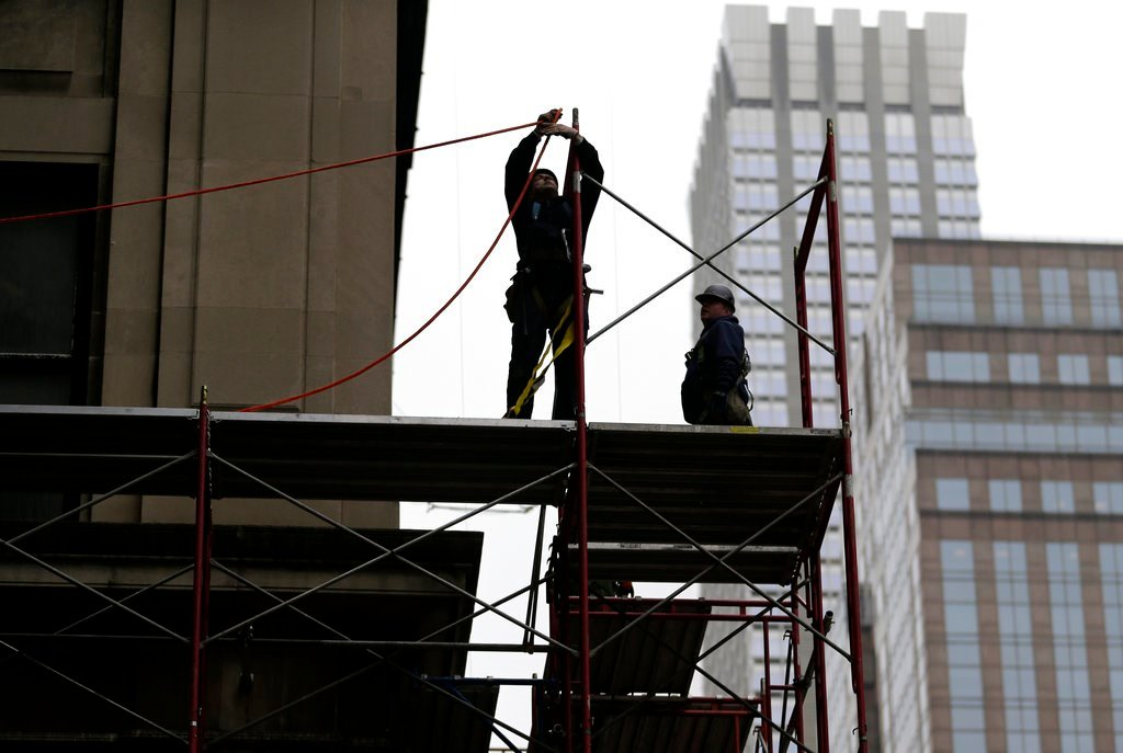 FILE- In this Feb. 20, 2018, file photo, construction workers work in midtown Manhattan in New York. U.S. productivity grew at an annual rate of 0.7% in the first 3 months of 2018.(AP Photo/Seth Wenig, File)