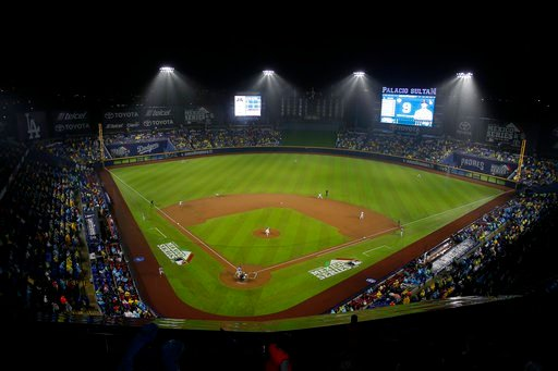 Fans watch a regular-season major league baseball game between the San Diego Padres and the Los Angeles Dodgers in Monterrey, Mexico Friday, May 4, 2018. (AP Photo/ Eduardo Verdugo)