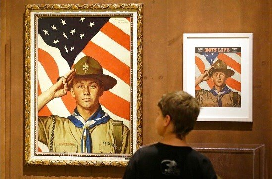 In this July 22, 2013, file photo, Andrew Garrison, 11, of Salt Lake City, looks over the Rockwell exhibition at the Mormon Church History Museum in Salt Lake City, Utah. (AP Photo/Rick Bowmer, File)