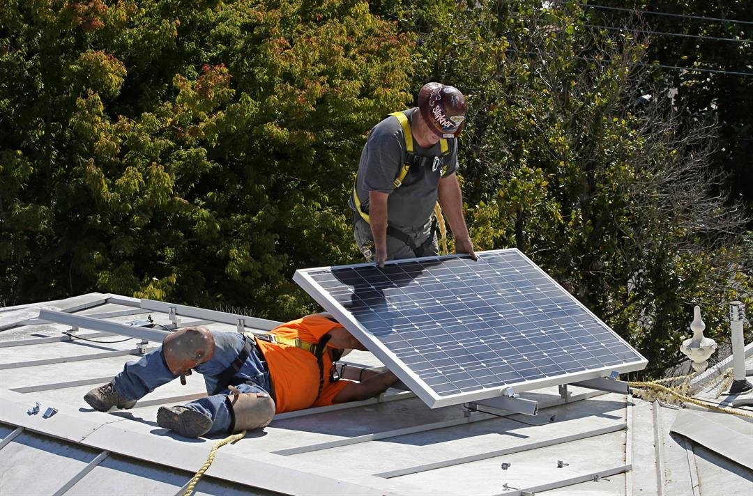 In this file photo a solar panel is installed on the roof of the Old Governor's Mansion in Sacramento. The CA Energy Commission will take up a proposal to require solar panels on new residential homes starting in 2020. (AP Photo/Rich Pedroncelli)
