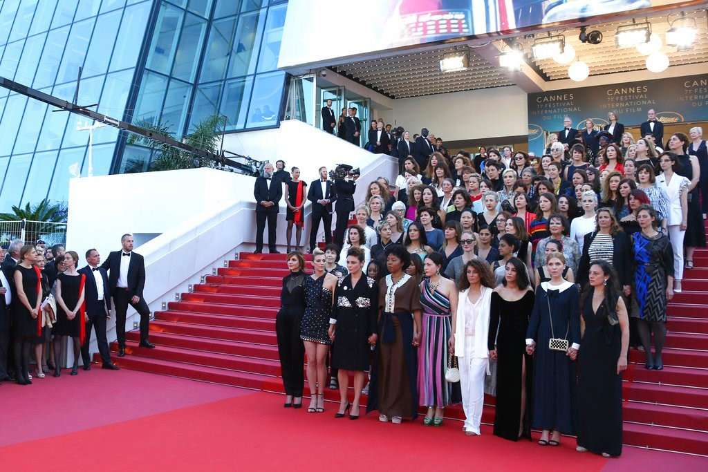 82 film industry professionals stand on the steps of the Palais des Festivals to represent, what they describe as pervasive gender inequality in the film industry. (Photo by Joel C Ryan/Invision/AP)