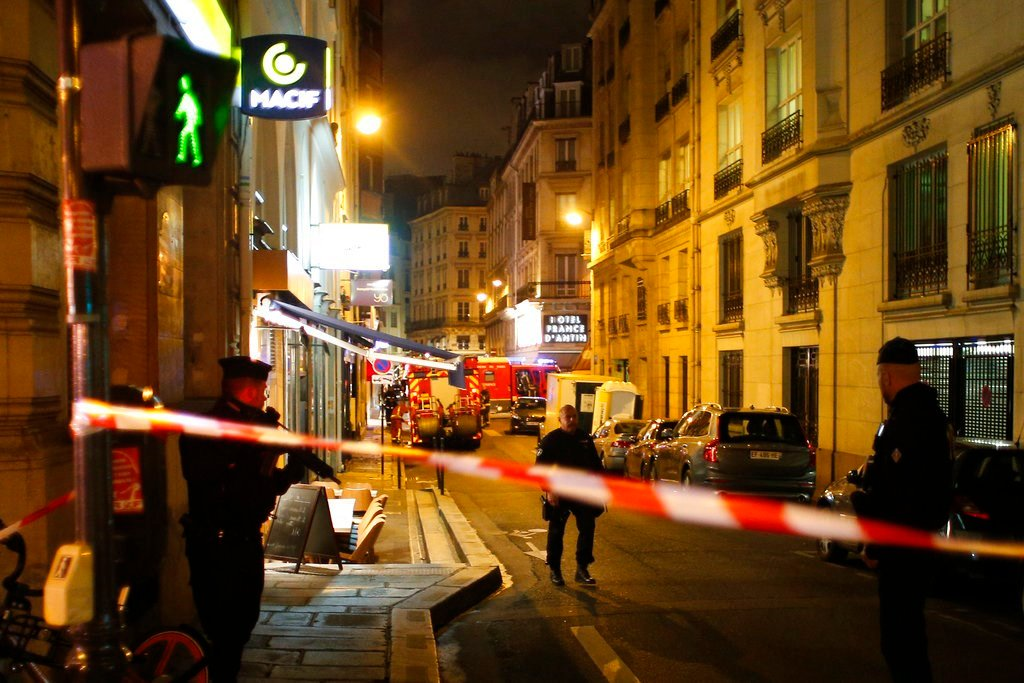 Police officers cordon off the area after a knife attack in central Paris. The Paris police said the attacker was subdued by officers during the stabbing attack in the 2nd arrondissement or district of the French capital Saturday.(AP Photo/Thibault Camus)