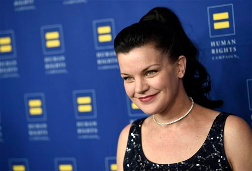 Actress Pauley Perrette poses at the Human Rights Campaign 2016 Los Angeles Gala Dinner at the JW Marriott LA Live on Saturday, March 19, 2016, in Los Angeles. (Photo by Chris Pizzello/Invision/AP)