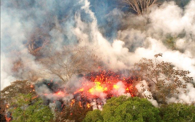 May 16, 2018, image provided by the U.S. Geological Survey shows lava spattering from an area between active Fissures. (U.S. Geological Survey via AP)