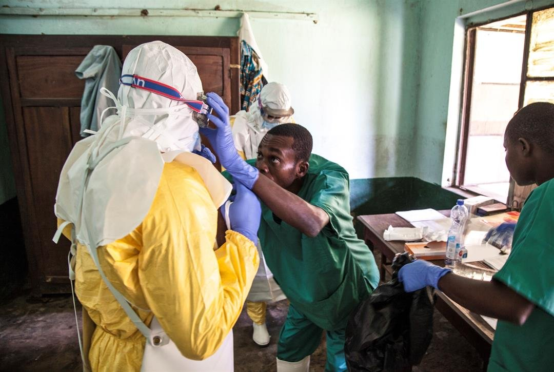 Health workers don protective clothing as they prepare to attend to patients in the isolation ward to diagnose and treat suspected Ebola patients, at Bikoro Hospital last week, in Congo. (Mark Naftalin/UNICEF via AP)