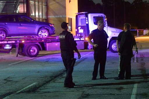 One person was killed and another wounded when an argument led to a shooting outside a high school graduation ceremony Friday night in metro Atlanta, police said. (AP Photo/John Amis)