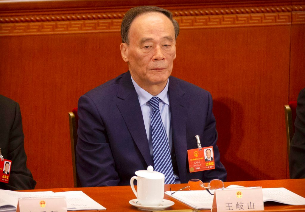 Chinese President Xi Jinping is increasingly turning to trusted confidant Wang Qishan to help guide the country's foreign relations as he prepares for a potentially bruising trade fight with the U.S. (AP Photo/Mark Schiefelbein)