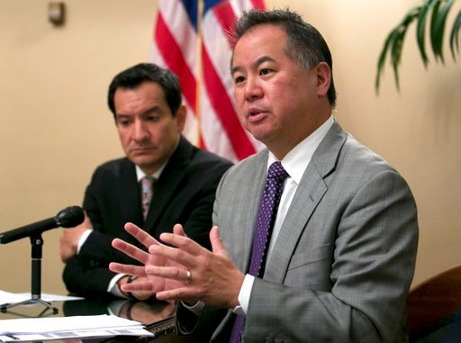 FILE - In this June 13, 2017, file photo, Assemblyman Phil Ting, D-San Francisco, right, discusses the state budget in Sacramento, Calif. (AP Photo/Rich Pedroncelli,File)