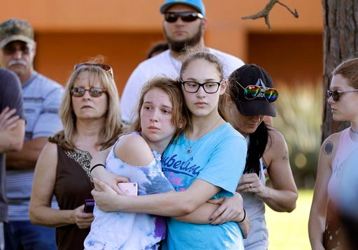 FILE - In this Friday, May 18, 2018, file photo, mourners wait for the start of a prayer vigil following a deadly shooting at Santa Fe High School in Santa Fe, Texas. (AP Photo/David J. Phillip, File)
