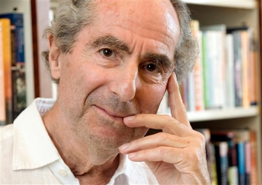 FILE - In this Sept. 8, 2008 file photo, author Philip Roth poses for a photo in the offices of his publisher Houghton Mifflin, in New York. (AP Photo/Richard Drew, file)