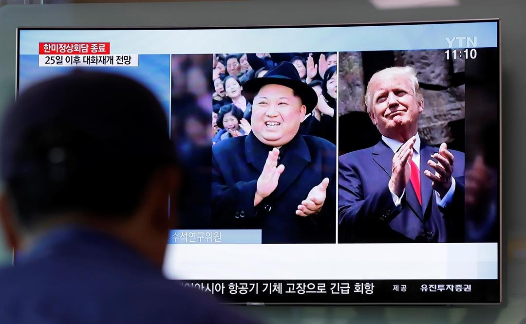 A man watches a TV screen showing file footage of U.S. President Donald Trump, right, and North Korean leader Kim Jong Un, left, during a news program at the Seoul Railway Station in Seoul, South Korea. (AP Photo/Lee Jin-man)