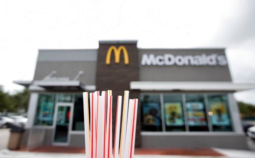 Plastic straws from a McDonald's restaurant are shown, Thursday, May 24, 2018, in Doral, Fla. McDonald's isn't ready to stop offering plastic straws, despite environmental concerns. (AP Photo/Wilfredo Lee)