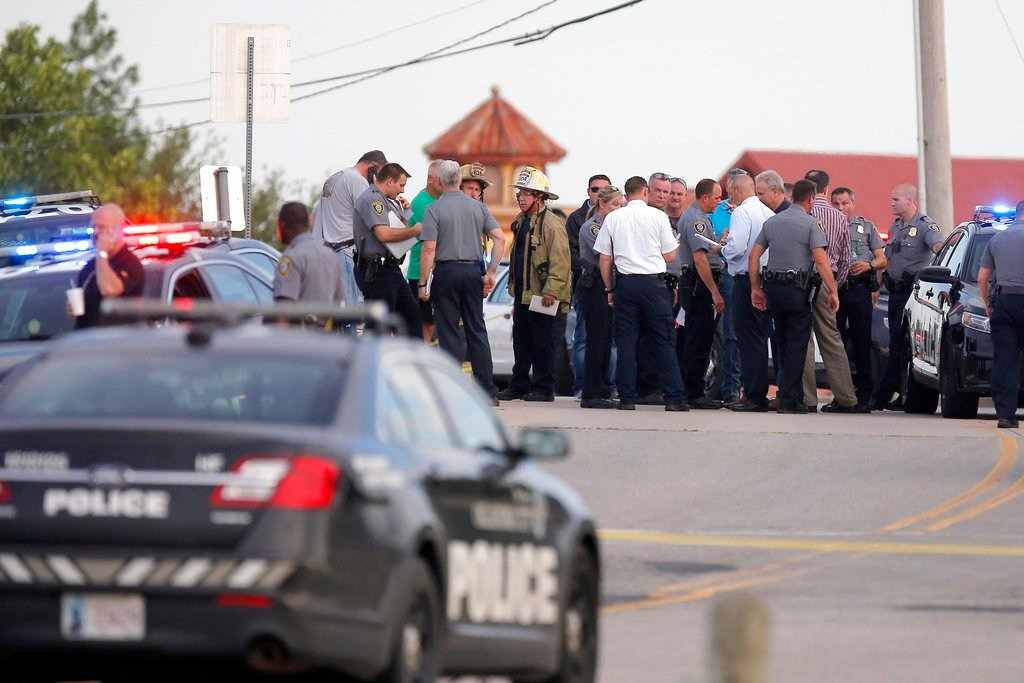 Police & emergency personnel surround scene of a shooting at Lake Hefner in Oklahoma City. A man walked into a restaurant and opened fire, wounding two customers, before being shot dead by a handgun-carrying civilian. (Bryan Terry/The Oklahoman via AP)