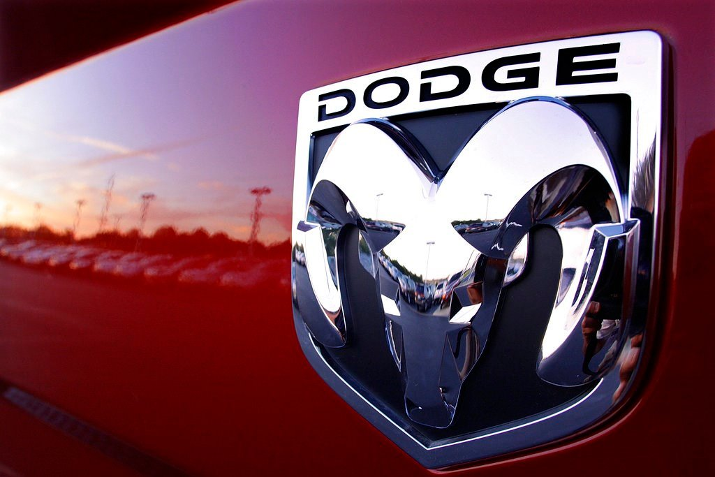This file photo shows a Dodge Ram logo at a dealership in Springfield, Ill. Fiat Chrysler is recalling 4.8 million vehicles in the U.S. because in rare circumstances, drivers may not be able to turn off the cruise control. (AP Photo/Seth Perlman, File)