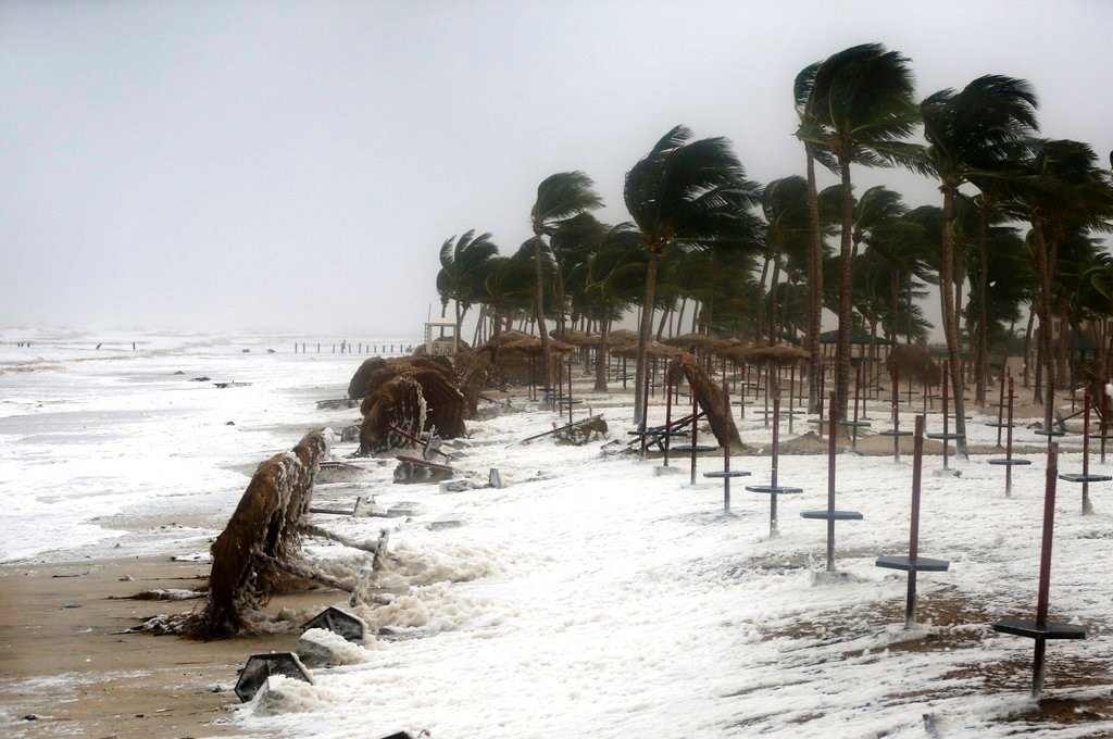 Debris and sea foam litters a beach after Cyclone Mekunu in Salalah, Oman. Cyclone Mekunu blew into the Arabian Peninsula on Saturday, drenching arid Oman and Yemen with rain, cutting off power lines, officials said. (AP Photo/Kamran Jebreili)