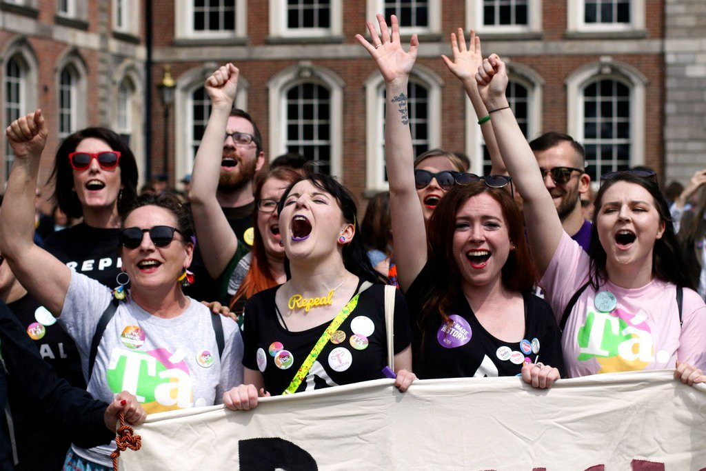 "People from the ""Yes"" campaign react as the results of the votes begin to come in, after the Irish referendum on the 8th Amendment of the Irish Constitution at Dublin Castle, in Dublin, Ireland. (AP Photo/Peter Morrison)"
